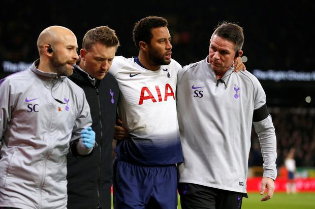 SETBACK: Mousa Dembele is assisted off the pitch. Photo: Action Images via Reuters