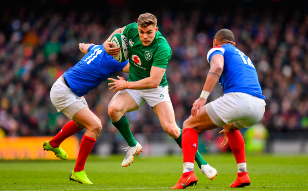 STEPPING OUT: Garry Ringrose of Ireland in action against Yoann Huget (left) and Gael Fickou of France. Photo: Sportsfile
