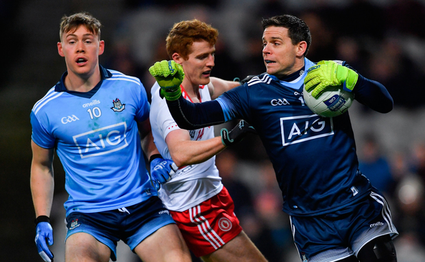 UNDER PRESSURE: Dublin goalkeeper Stephen Cluxton in action against Peter Harte of Tyrone as Con O'Callaghan looks on during the Allianz Football League match at Croke Park last Saturday. Photo: SPORTSFILE