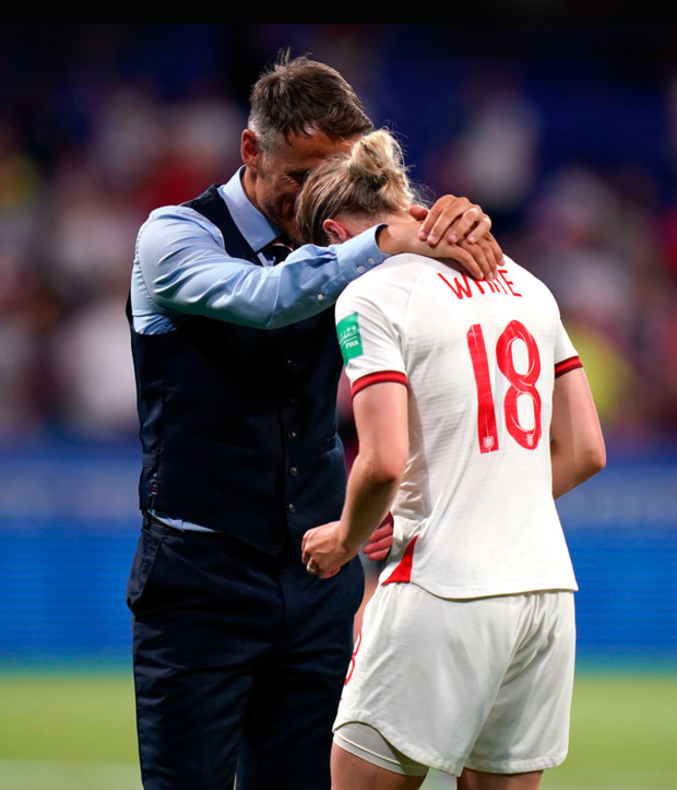 England head coach Phil Neville (left) comforts and Ellen White after defeat by the USA