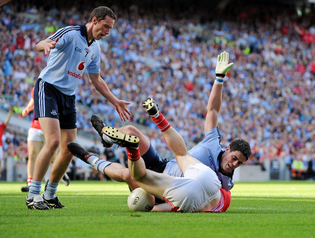 HEARTBREAK: Dublin's Ross McConnell fouls Cork's Colm O'Neill, which led to a penalty being awarded by referee Maurice Deegan as the Rebels advanced to the 2010 All-Ireland final. Picture credit: David Maher / Sportsfile