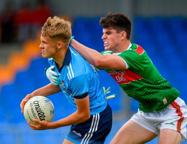 Getting free: Alex Rogers of Dublin in action against Alfie Morrison of Mayo. Photo: Sportsfile