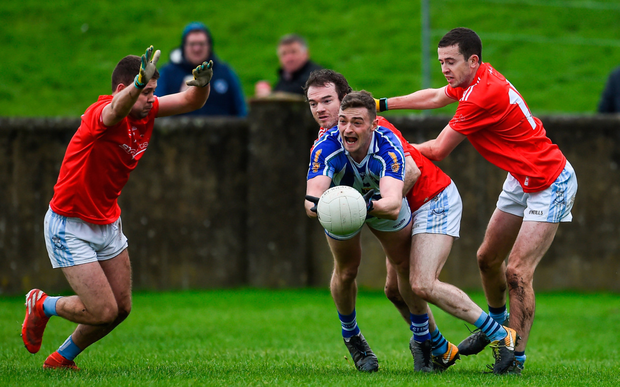 Aran Waters of Ballyboden St Enda's in action against Ian Connor, Colm Judge, and Robert Carr of Newtown Blues. Photo: Sportsfile