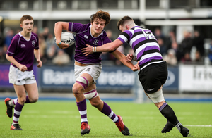 Clongowes' Tom Mulcair is tackled by Terenure College's Matthew McGetrick-Stafford