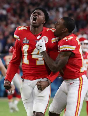 Kansas City Chiefs' Sammy Watkins and Mecole Hardman celebrate after the game