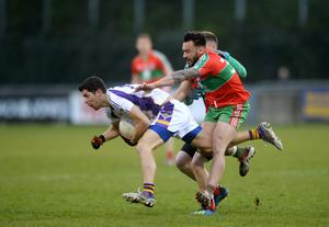BACK IN ACTION: Rory O'Carroll in action for Kilmacud Crokes against Ted Furman of Ballymun Kickhams at Parnell Park