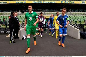 Stephen Ward leads out Ireland in yesterday's friendly