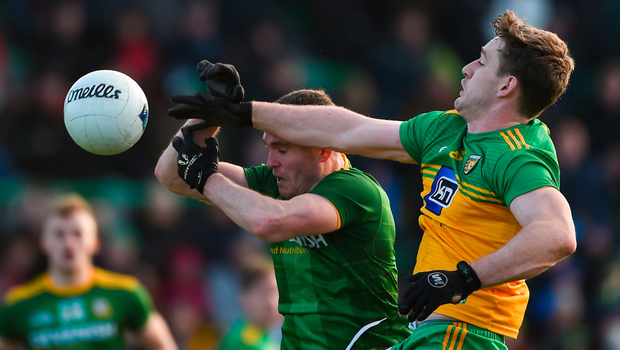 BATTLE: Hugh McFadden of Donegal in action against Bryan Menton of Meath. Pic: Sportsfile