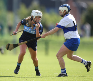 St Jude's Aisling Darcy (l) finds a way past Áine Fanning of St Vincent's during the Dublin Senior Camogie Championship final