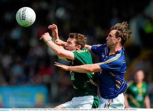 Meath's Joseph Wallace battles for possession with Wicklow's Aaron Murphy