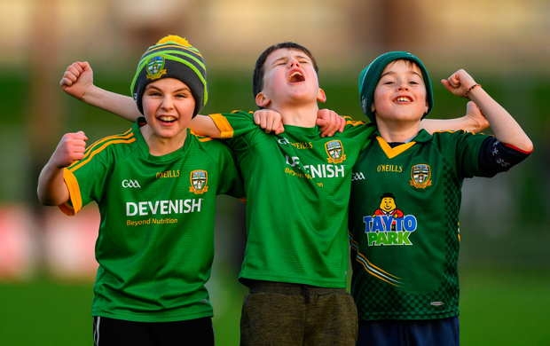 Meath supporters (l-r), Luke Casey (10) and Max Farrelly (11), both from Navan O'Mahony's, and Finian Collier (10), from Bective, celebrate after the Seán Cox Fundraising match between Meath and Dublin at Páirc Tailteann, Navan