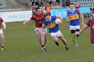 Ciarán Kilkenny holds off the attentions of Plunkett's Declan Lally at Parnell Park. Pic: Justin Farrelly