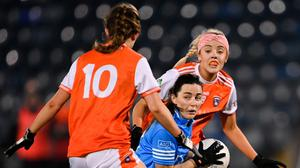 Dublin's Lyndsey Davey jinks around Armagh's Catherine Marley (l) and Niamh Coleman