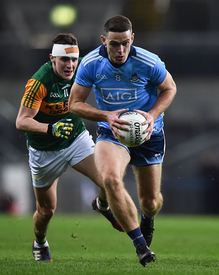 BEST OF THE BEST: Dublin's Brian Fenton is chased by Seán O'Shea of Kerry