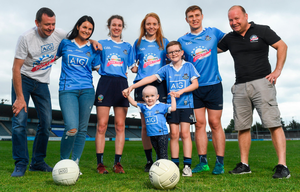 Jersey day: John and Lorraine Groves, Dublin camogie player Doireann Mullany, Dublin ladies footballer Ciara Trant, Evie Groves, who benefited from the childrens' charity Aoibheann's Pink Tie with her brother Seán, Dublin footballer John Small and Mick Rochford, Co-Founder of Aoibheann's Pink Tie at the Aoibheann's Pink Tie Dublin GAA jersey takeover in Parnell Park yesterday. Photo: Sportsfile
