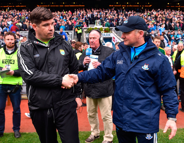 Kerry manager Eamonn Fitzmaurice shakes hands with Dublin manager Jim Gavin