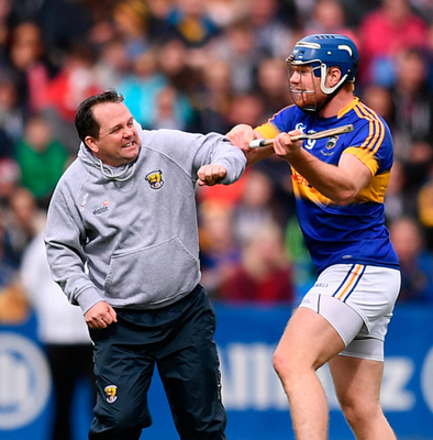 Wexford manager Davy Fitzgerald clashes with Jason Forde of Tipperary during the Allianz Hurling League semi-final. Photo: Sportsfile