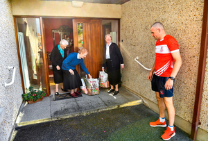 HELPING HAND: Monaleen GAA player David Power delivers shopping to The Sisters of the Little Company of Mary, including (l-r) Sister Alice Culhane, Sister Breda Conway and Sister Denise Maher in Milford, Limerick. GAA clubs nationwide help out their local communities during restrictions imposed by the Irish Government in an effort to contain the spread of the Coronavirus pandemic. GAA facilities reopened on Monday June 8 for the first time since March 25 with club matches provisionally due to start on July 31 and intercounty matches due to to take place no sooner than October 17. Photo: Sportsfile