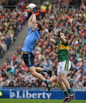Dublin's Rory O'Carroll wins a dropping ball ahead of Kerry's Paul Geaney during the 2015 All-Ireland Football Final at Croke Park