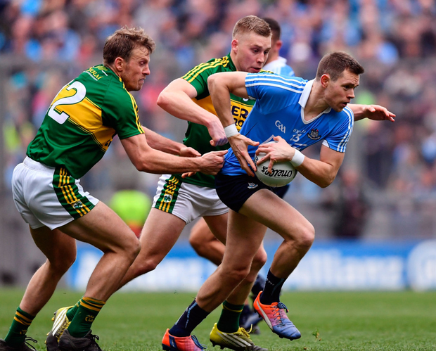 Dublin's Dean Rock is tackled by Kerry's Donnchadh Walsh and Peter Crowley
