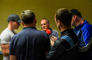 Dublin manager Mattie Kenny speaks to Conor McKeon after the Laois loss last July