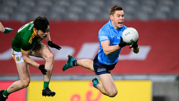 FLYING FORWARD: Dublin's Con O'Callaghan fires off a handpass against Meath on Saturday. Photo: Stephen McCarthy/Sportsfile