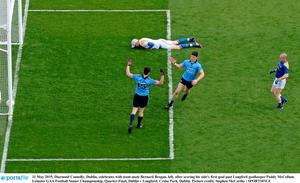Diarmuid Connolly, Dublin, celebrates with team-mate Bernard Brogan, left, after scoring his side's first goal past Longford goalkeeper Paddy McCollum.