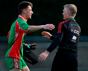 Ballymun Kickhams goalkeeper Evan Comerford and his manager Brendan Hackett celebrate