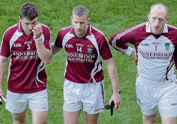 Westmeath players, from left to right, Kieran Gavin, Denis Glennon, Gary Connaughton and trainer Joe Quinn leave the pitch after defeat to Dublin. Picture credit: Diarmuid Greene / SPORTSFILE