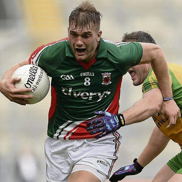 Mayo's Aidan O'Shea in action against Michael Murphy. Picture: Stephen McCarthy / SPORTSFILE