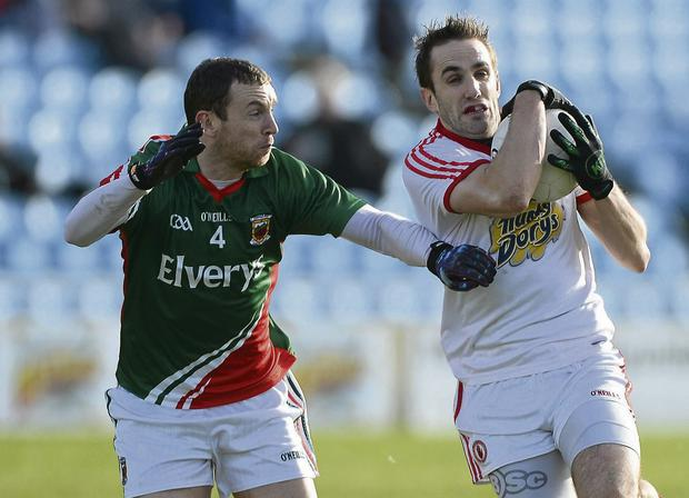 Mark Donnelly, Tyrone, in action against Keith Higgins, Mayo. Picture: Brian Lawless / Sportsfile