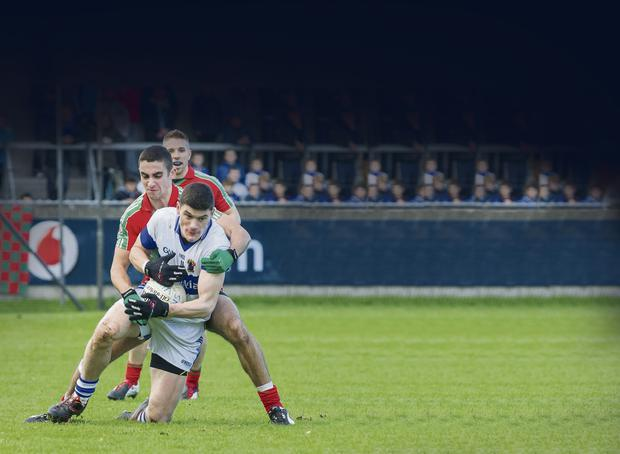 James McCarthy of Ballymun Kickhams tussles with Vincent's Diarmad Connolly. Picture: www.doug.ie