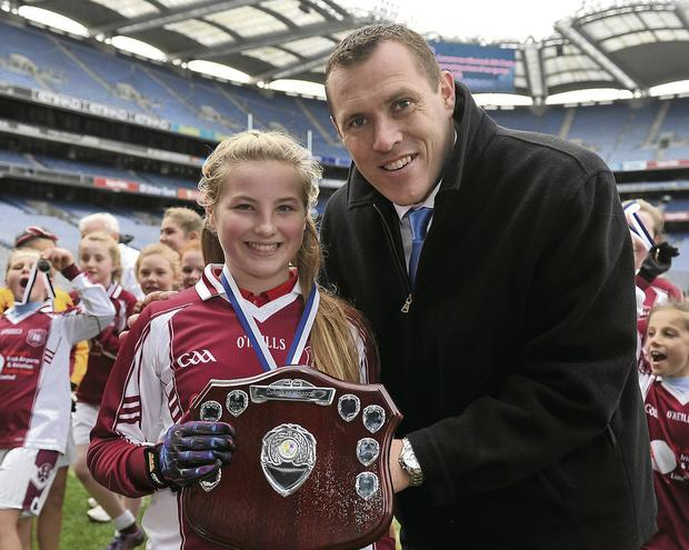 Holy Family SNS, Swords captain Robyn Lynch, receives the winning trophy from Ciaran Whelan. Picture: Barry Cregg / SPORTSFILE