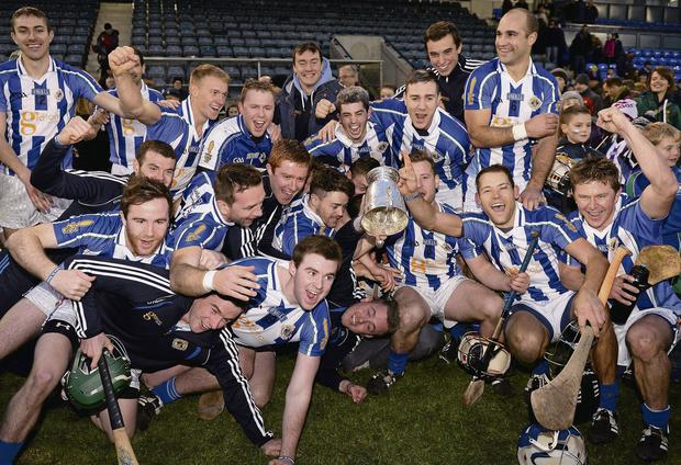 Ballyboden St Enda's players and management celebrate with the cup after the county final. Picture: Ray McManus / SPORTSFILE