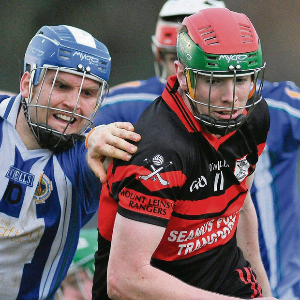 Mount Leinster Rangers' Edward Byrne in action against Ballyboden St Enda's Conal Keaney. Picture credit: Pat Murphy / SPORTSFILE