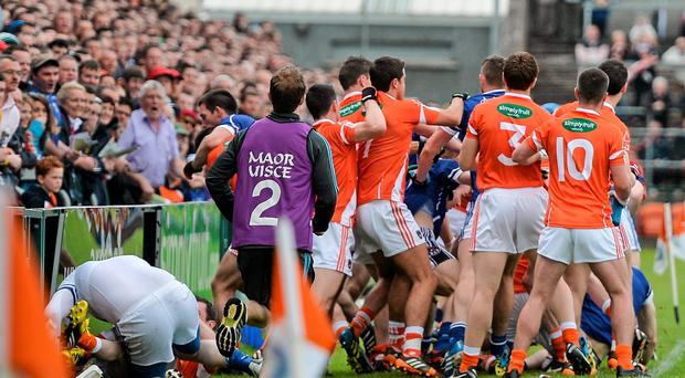 Players from both sides involved in a disagreement before the pre-match parade. Picture: Ramsey Cardy/SPORTSFILE