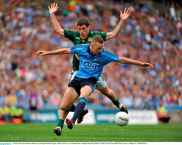 Paul Mannion, Dublin, in action against Donal Keogan, Meath. Picture credit: Ashleigh Fox / SPORTSFILE