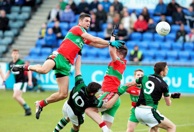 Ballymun's James McCarthy and Elliott Reilly gets the better of Parnell's Willie Henry and Colm Begley in the Dublin Senior Football Championship at Parnell Park.