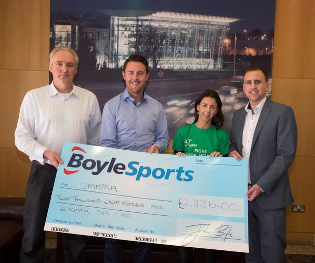 Gayle Cummins of the Irish Motor Neurone Disease Association (IMNDA) receiving a cheque of €2,886.00 which was raised from 'Beat the Bookies' feature in the Herald. Presenting the cheque from left, Herald Sports Editor Pat Keane, Leon Blanche of Boylesport