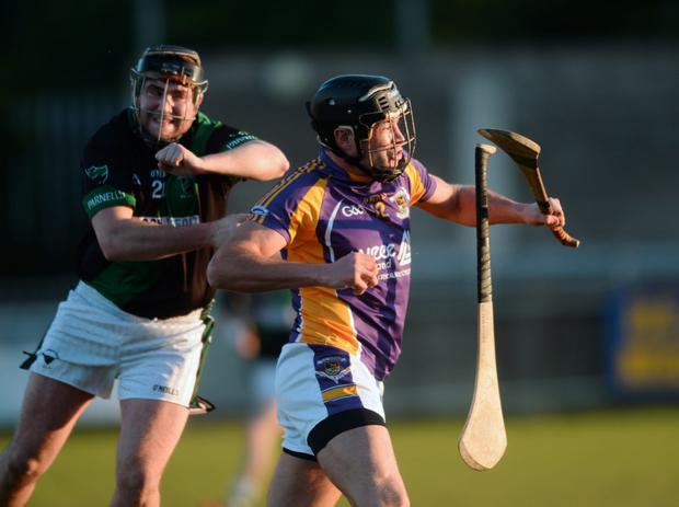 Jude Sweeney, Kilmacud Crokes, in action against Carl Sammon, Parnells, who loses his hurley.