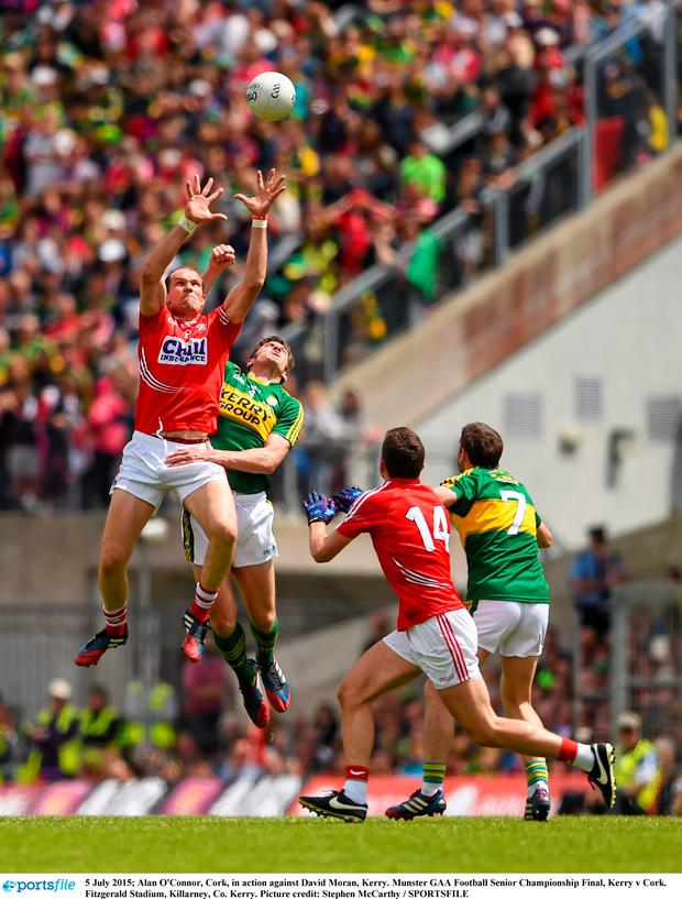 Alan O'Connor, Cork, in action against David Moran, Kerry. Munster GAA Football Senior Championship Final, Kerry v Cork. Fitzgerald Stadium