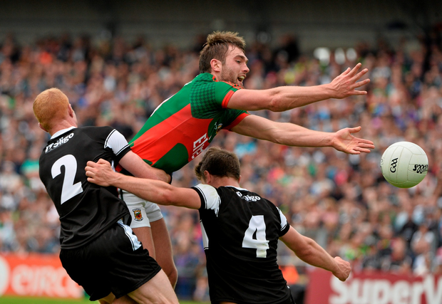 Mayo's Aidan O'Shea in action against Ross Donavan (left) and Daniel Maye of Sligo during the Connacht SFC final at Dr Hyde Park