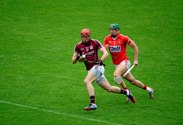 Galway's Jonathan Glynn tries to race clear of Galway's Aidan Walsh