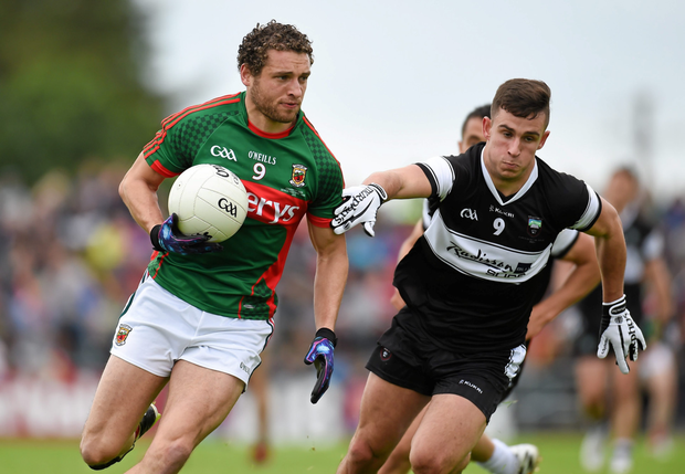 Mayo's Tom Parsons glides past Sligo's Niall Murphy in their one-sided Connacht SFC final victory in July at Dr Hyde Park, Roscommon. Pic: Paul Mohan/Sportsfile