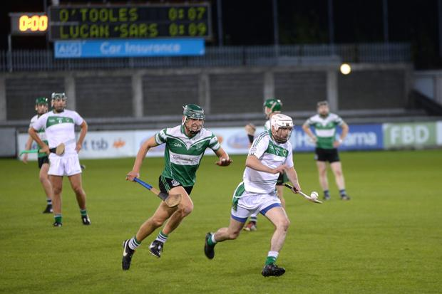 O'Toole's Peadar Carton tries to accelerate away from Lucan's Chris Crummey in last night's Dublin SHC quarter-final at Parnell Park
