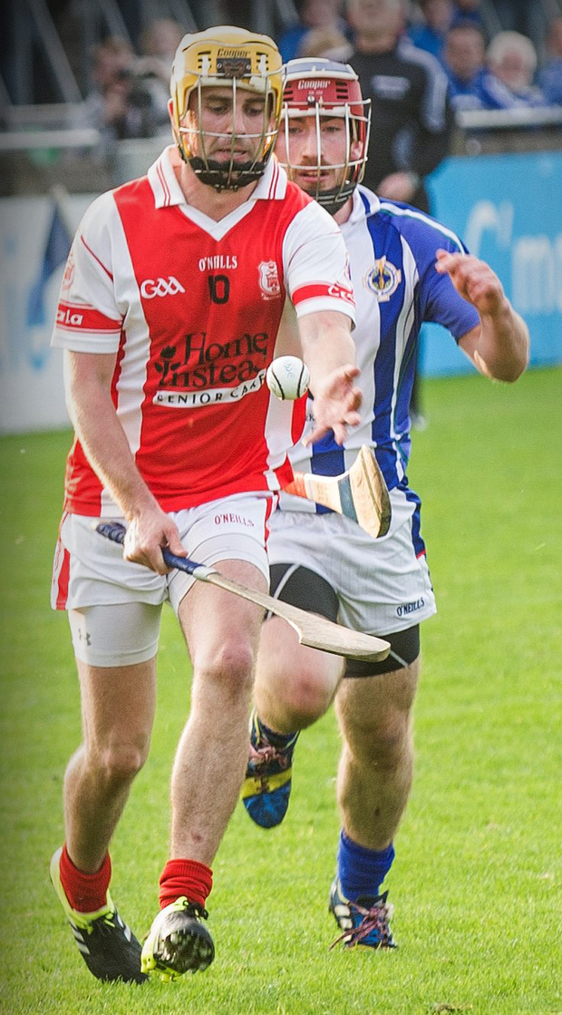 Cuala's Cian Waldron is chased by Ballyboden's Matty Weldon during the Dublin SHC 'A' semi-final in Parnell Park