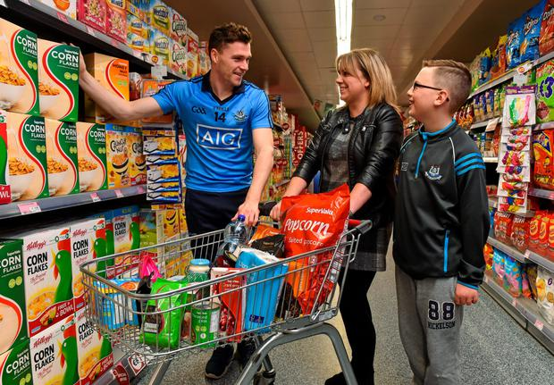 Dublin's Paddy Andrews with Lisa and Seán Murphy from Aughrim, Wicklow, who were in SuperValu, Knocklyon