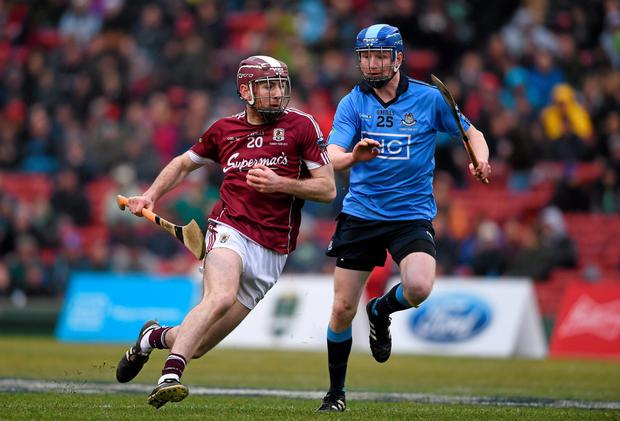 Padraic Mannion of Galway, in action against Dublin's Fíontan McGibb during the AIG Fenway Hurling Classic.