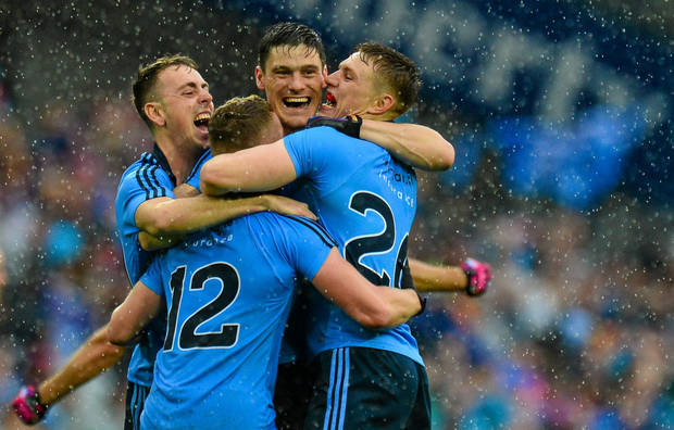 Dublin players (l-r) Cormac Costello, Ciarán Kilkenny, Diarmuid Connolly and Davy Byrne celebrate after All- Ireland final victory over Kerry (SPORTSFILE)