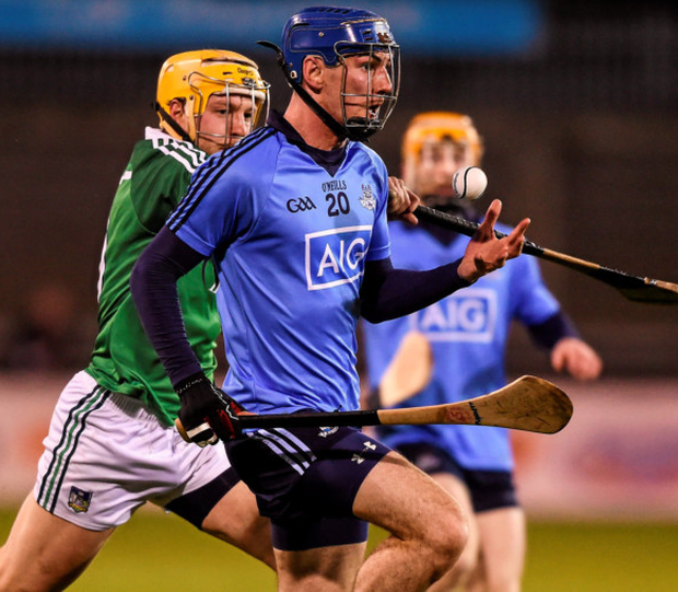 Dublin's Daire Plunkett under pressure from Limerick's Paul Browne. Photo: Sportsfile